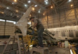 Ray Davis (cq), works on a wing of a Airbus 319, Thursday afternoon, January 3, 2008, at the...