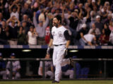 [ES POY] -Colorado Rockies first basemen Todd Helton rounds the bases after his two run home run...