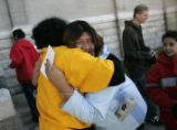 Sarah Estrada (cq), 15, cries as she gives Lovey Shipp (cq), a Father Woody elf, a big hug after...
