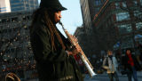 DM0779   Walter Dawkins, 57, plays his soprano saxophone for people passing by on the 16th Street...