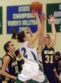 FRIDAY DECEMBER 22ND, 2007 photo by Kirk Speer.  Doherty High School's Emily Tekavec (#22) center,...
