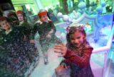 MJM326 Jamie Morgan (cq), 6, of Englewood, Colo. has a fake snow fight with her brother after they...