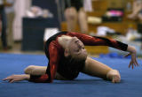 Loveland's Hannah Bower, who won the all-around competiton, performs her floor exercise routine at...
