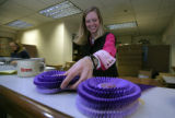 Working as an intern, Stacia Berry, 24 organizes the many ribbons to be awarded during the...