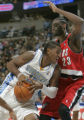 Denver Nuggets forward Carmelo Anthony, left, drives on Portland forward Darius Miles, right, in...