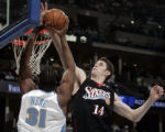 Denver Nuggets forward Nene, left, is blocked by Colorado native Jason Smith, right, in the first...