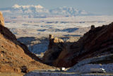 Trucks and cars negotiate the geological feature called the San Rafael Swell on Interstate 70 just...