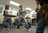Pomona High School junior Mitchell Reid (cq, center), playing McDonwald, acts out a scene from...