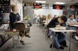 School Review Team member Jody Whitley (cq, left) observes teacher Jeremy Lustik's Pre-Algebra...
