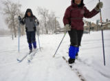 DM0457   Norm Aaronson, left, and his wife Evelyn Hutt ski through Washington Park in Denver,...