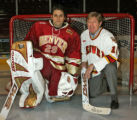 DU goalies, Peter Mannino (cq), goalie today, left, and Gerry Powers (cq), goalie of the past, in...