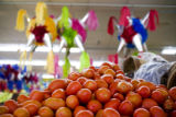 Pinatas hang from the ceiling in the feresh produce section at Avanza market on Jan. 3, 2008. Eat!...