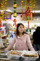 Cashier, Tam Tran, (cq) from Vietnam and currently living in Denver works at the Little Saigon...