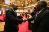 New Senate President Peter Groff shakes hands with his father, form state senator Regis Groff, as...