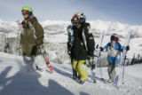 L-R, Middle school free skiers  Max Darsonvow, Mathew Evans,and Aaron Blunk, hike the deck of  the...