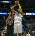 Denver Nuggets forward Carmelo Anthony drains a three point shot at the buzzer over , Milwaukee...