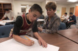 Project Respect member Michael Maez (CQ), 14, does some work with advocate Shirley Arriaga, of...