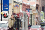 CARBONDALE - Ron Speaker checks for voice mail on his cell phone on Main Street in bustling...