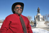 Vern Hpward (cq) chief organizer of Martin Luther King Jr. holiday events, at the MLK statue in...