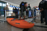 DM0747   Patrick Rogers, 22, of Steamboat Springs drags his kayak through the line to check-in for...