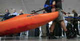 DM0784   Patrick Rogers, 22, of Steamboat Springs drags his kayak through the line to check-in for...