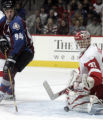 The Colorado Avalanche's Ryan Smyth, left,  shot is blocked by  Detroit Red Wings' goaltender...