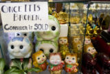 Piggy banks are stacked on shelves in preparation for the Chinese New Year at the Truong An...