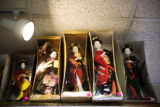 Dolls are for sale on a tall shelf at the Truong An giftshop in the Far East Center, on Jan. 3,...