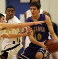 Boulder High Schools Joe Hoolas gets pressure from Mullens High Schools Brennan Belloni (left) and...