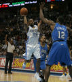 [ JPM0614 ] Denver Nuggets Anthony Carter (25) puts up a shot against Orlando Magic Dwight Howard...