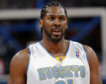 NY172 - ** FILE ** Denver Nuggets forward Nene, of Brazil, waits to make a free throw against the...