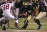 0747 University of Colorado #29 Cha'pelle Brown picks up a fumble against the University of...