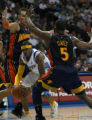 The Denver Nuggets Allen Iverson, squeezes through Golden State Warriors Andris Biedrins and Baron...