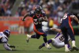 DM1258   Denver Broncos running back Selvin Young scrambles to the outside in the second quarter...