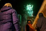 Hundreds of poeple filled the streets of downtown Denver to welcome the arrival of 2008, during...