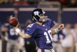 Eli Manning throws the ball in the 4th quarter of the Denver Broncos against the New York Giants...