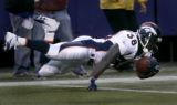 Mike Anderson leaps for extra yardage near the goal line in the 3rd quarter of the Denver Broncos...
