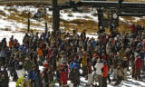 A large crowd waits at the Exhibition Chair for their turn to get up on the mountain Sunday...
