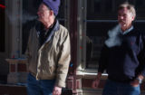 Brothers Joe and Paul Eccher  smoke outside of the Century Hotel and Casino in Central City, CO on...