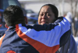 DM0301   Josue Olivas, left, and Norma Kaholo, both relatives of 11-year-old Angelica Martinez,...