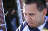 DM0363   Josue Olivas fights back the tears as he talks with reporters about his sister in law...