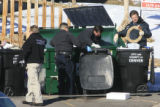 DM0644   Police search a dumpster across the gulch from where Angelica Martinez, 11, and another...