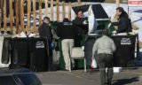 DM0664   Police search a dumpster across the gulch from where Angelica Martinez, 11, and another...