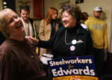 Edwards supporters MaryAnn Ruggiero (cq), left, laughs at a joke by Marie Collins (cq) before...