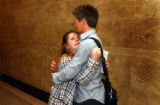Denver, Colo.-June 1,2004- Kellie Tingue, girlfriend of murder victim Garry McLaughlin, hugs a...