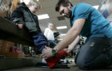 Adam Baer (cq)  fits 7 year old Oliver England for rental rental boots at Christy Sports in Denver...