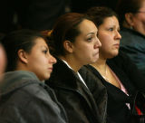 Unidentified friends  of Pedro Cortez (cq) watch as he makes his first appearance in Denver County...