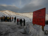 Members of the Summit  County Search and Rescue, look down at an avalanche at the top of Loveland...