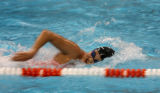 Jessica Rodriquez, (cq) former Cherry Creek High swimmer who is now an Olympic hopeful trains with...