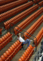 Frank Rodriquez, (cq) sits alone in the stands as he watches his daughter, Jessica Rodriquez, (cq)...